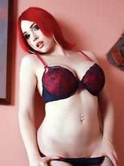 Busty redhead Sarina posing her goodies