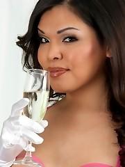 Seductive tgirl hottie Carmen having champagne