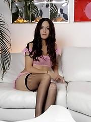 Seductive Nicole Montero posing on the couch