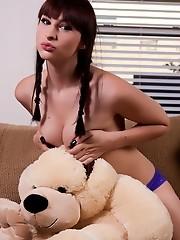 TS sweetheart Bailey Jay playing with a stuffed dog