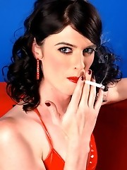 Seductive Mandy posing in red latex costume