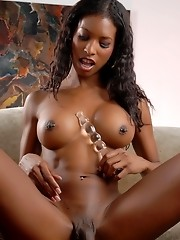 Horny ebony transsexual Natassia playing with her toy