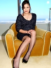Asian ladyboy Yuki is a brand new addition to Shemale Japan! She\'s a classy newhalf with legs for days and a tight black dress, stockings, and h